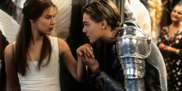 Claire Danes is surprised as Leonardo DiCaprio takes her hand to kiss in scene from the film 'Romeo + Juliet', 1996. (Photo b