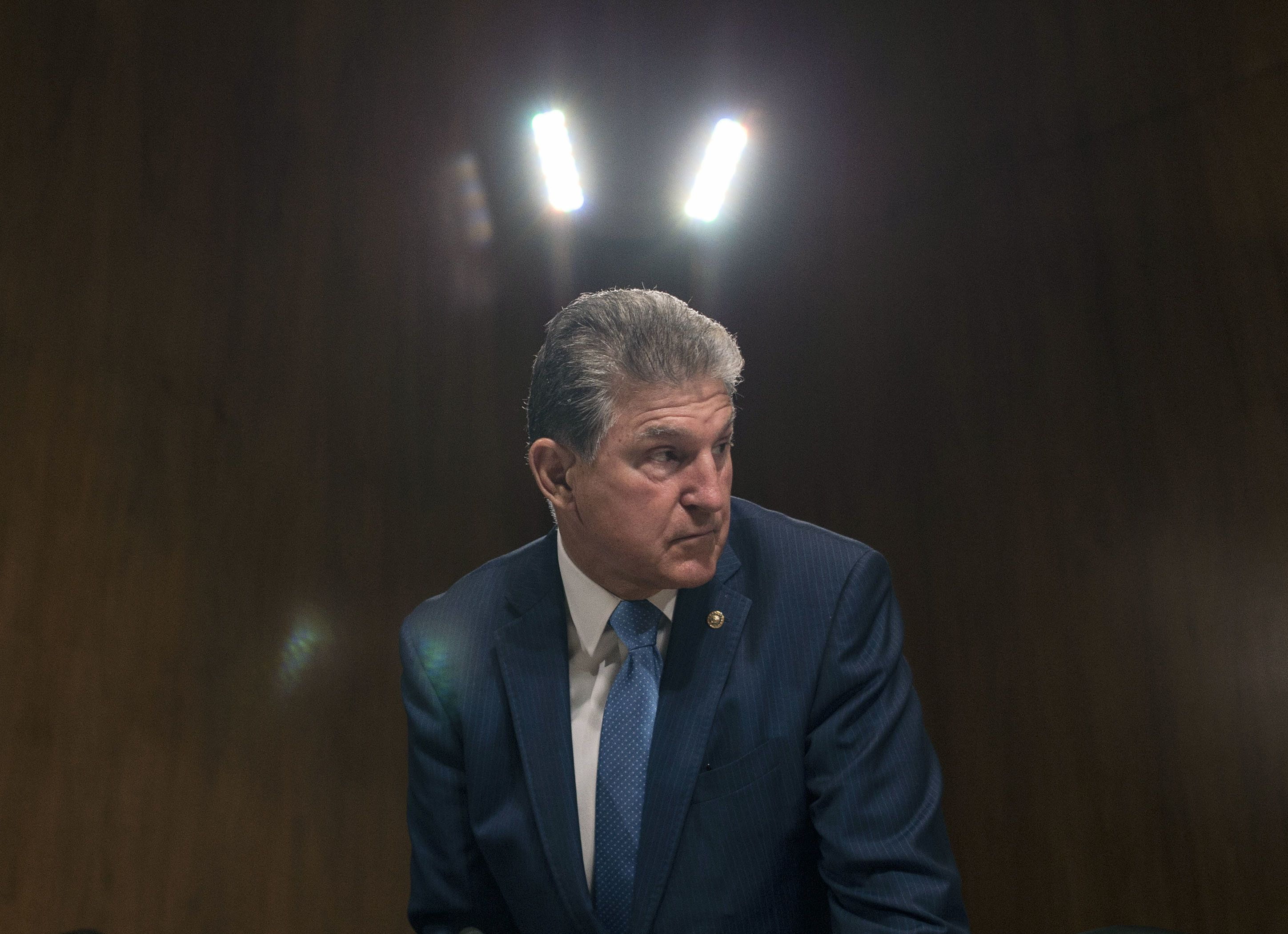 US Senator Joe Manchin (D-WV) looks on before the arrival of US Treasury Secretary Steven Mnuchin during a Senate Appropriations Committee for Financial Services hearing on the proposed FY2019 budget for the Treasury Department in Washington, DC on May 22, 2018. (Photo by Andrew CABALLERO-REYNOLDS / AFP)        (Photo credit should read ANDREW CABALLERO-REYNOLDS/AFP/Getty Images)
