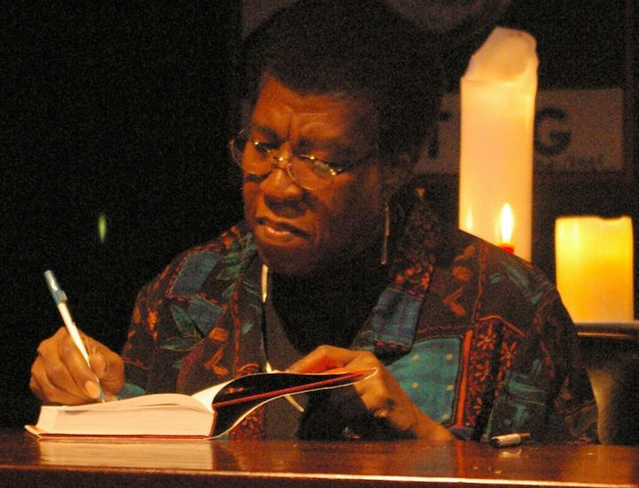 Description Octavia Estelle Butler signing a copy of Fledgling after speaking and answering questions from the audience.  The