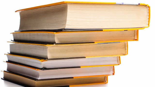 big stack of yellow books...