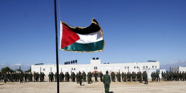 Palestinian officers from the national security forces loyal to Palestinian President Mahmoud Abbas participate in a military