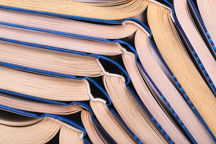 stack of open books close up