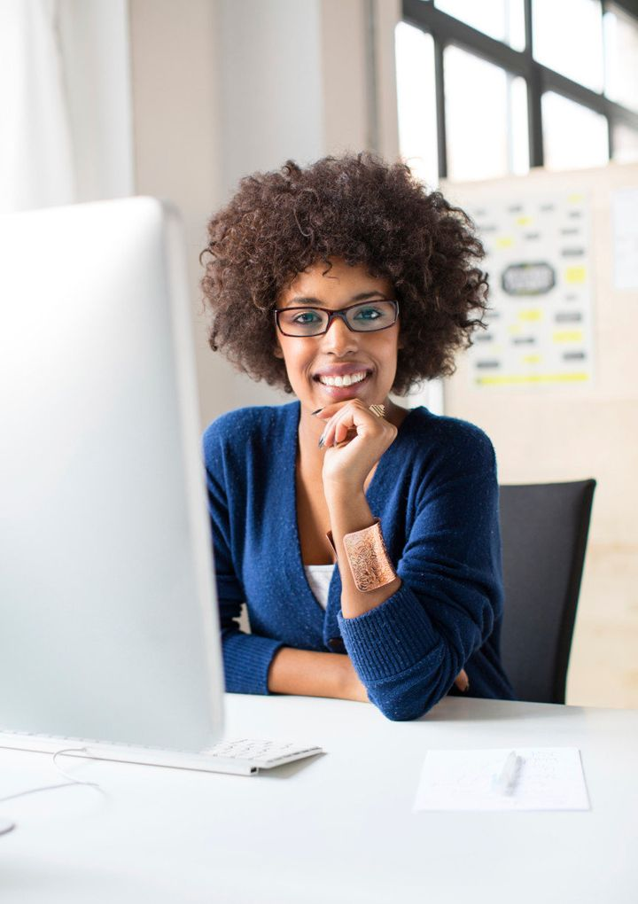 Picture of a young confident woman working at a start up. Perfect image representing women in the workplace