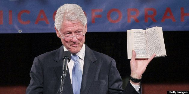 CHICAGO, IL - JANUARY 18:  Former U.S. President Bill Clinton reads an excerpt from his memoir about Rahm Emanuel, former Whi