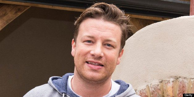 LONDON, ENGLAND - MAY 20:  Jamie Oliver makes and cooks a pizza in a stone oven at the Chelsea Flower Show press and VIP prev