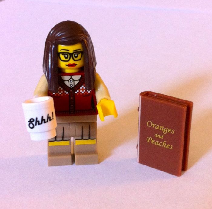 "The official Lego librarian – comes with a ""Shhh!"" cup and a book: ""Oranges and Peaches."""