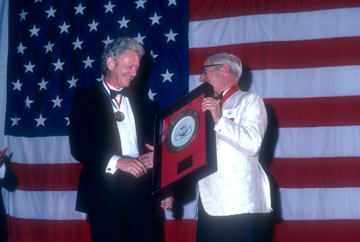 Leon Lederman receives an accolade at the Academy of Achievement Golden Plate Awards on June 24, 1982, in New Orleans.