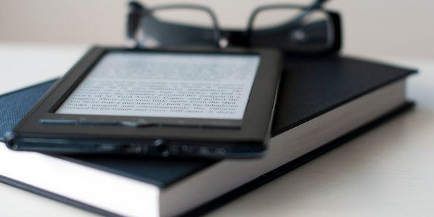 E-Reader and book with reading glasses.