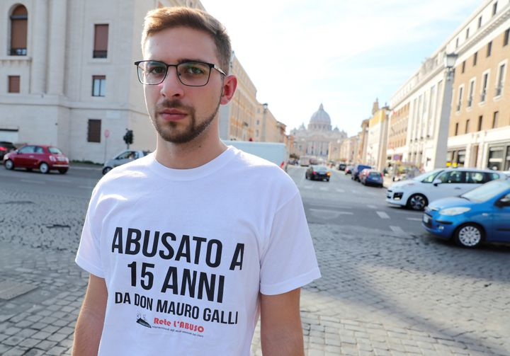 "Italian Abuse victim Alessandro Battaglia wears a t-shirt that says, ""Abused when I was 15 by father Mauro Galli"" as he demon"
