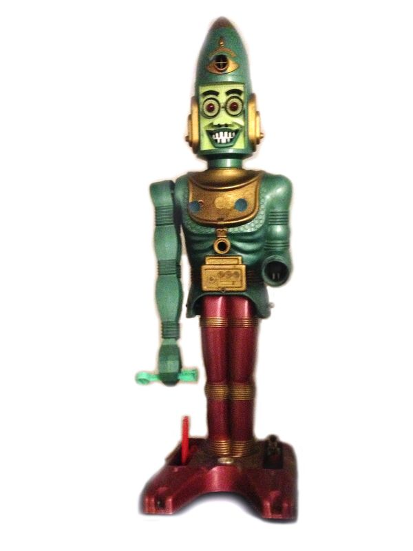 If there ever was a toy that tried to do <em>everything</em>, it was this three-foot tall, shiny green, red and gold robot fr