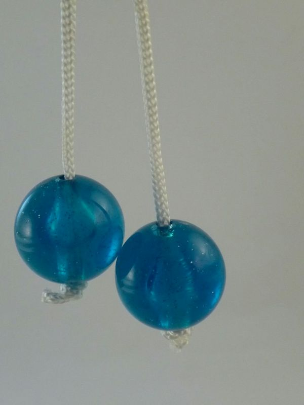 Now here's a brilliant idea. Give kids hard acrylic balls on string that they smash into each other at high speeds. Like the