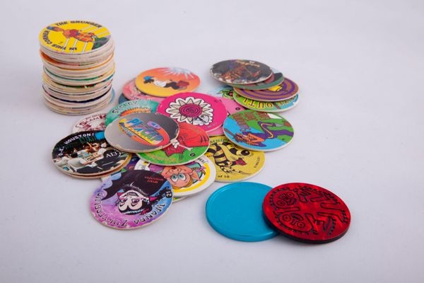 Hey, here's a million-dollar idea: get kids to spend their allowance money on decorated cardboard discs. Starting as cardboar
