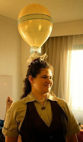 Here some friends created hot air balloon hats for a very silly event using string, ribbon, glue, and tiny baskets.