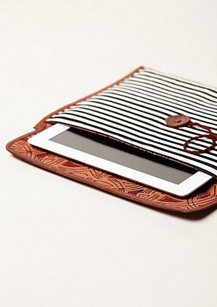 For the book lover in your life who prefers a glossy iPad screen to the Kindle or the Nook, this cloth case will go perfectly