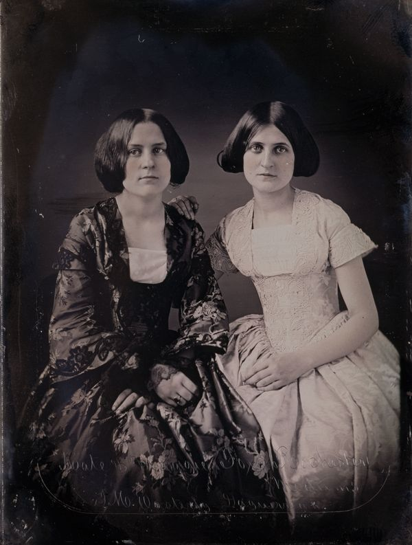 In 1848, Maggie, left, and Kate Fox played a joke on their mother by pretending to communicate with the spirit of a dead pedd