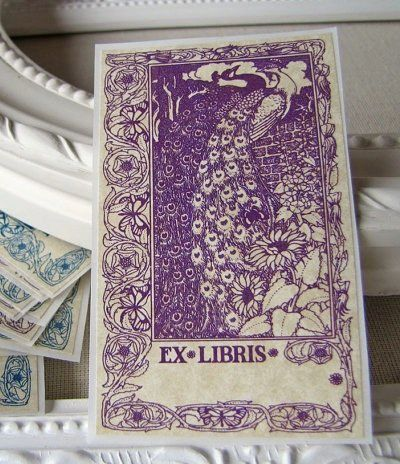 """If it's drama you crave, try these ornate purple and blue peacocks. <a href=""""https://www.etsy.com/listing/150086405/bookplate"""
