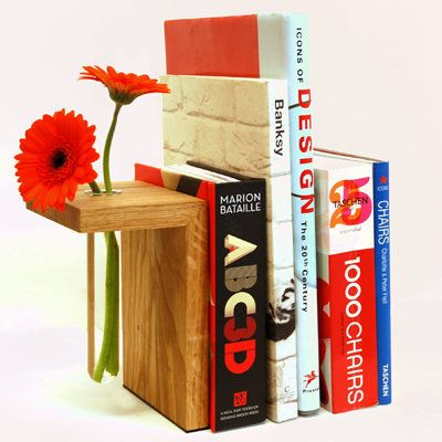 "Fresh-cut flowers and well-organized books: a perfect combination. (Via <a href=""http://www.adrahome.com/oak-vase-bookend-p-4"