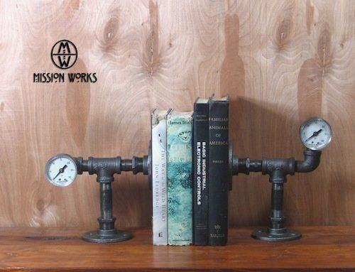 "These books appear to be under a lot of pressure. (Via <a href=""http://www.etsy.com/listing/150643574/bibliophile-metal-art-b"
