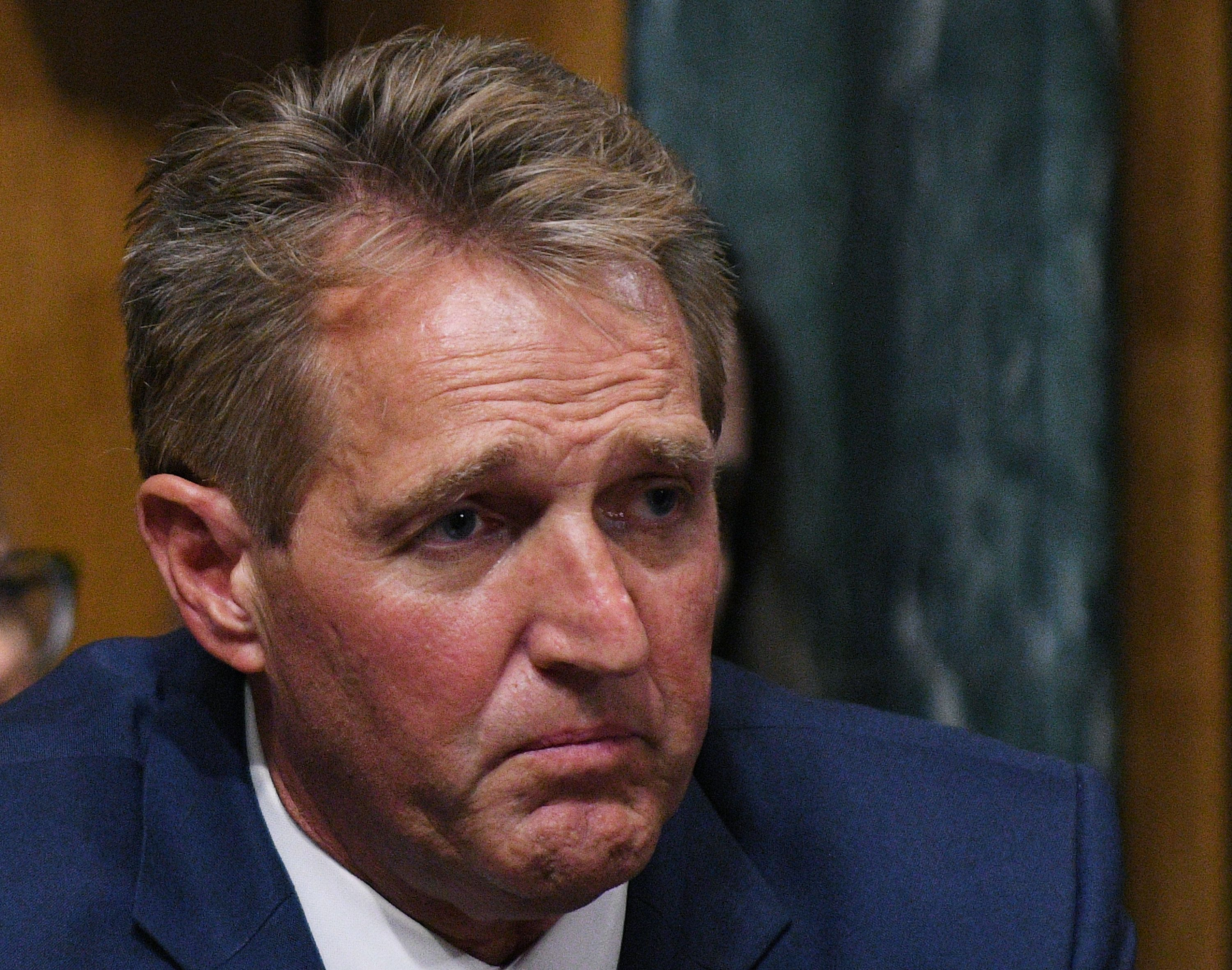Sen. Jeff Flake, R-AZ, calls for an FBI investigation during the Senate Judiciary Committee meeting to vote on the nomination of Brett M. Kavanaugh to be an associate justice of the Supreme Court of the United States in Washington, U.S., September 28, 2018.      REUTERS/Mary F. Calvert