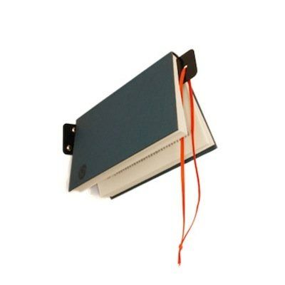 This is a fixture as much as it is a bookmark: Screw it into the wall near your favorite reading spot and ensure your current
