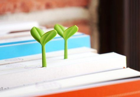 """Is it possible that there's a plant sprouting out of this book?? Or is it simply a very adorable placeholder? (<a href=""""http:"""