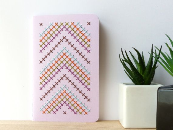 In case your Moleskine wasn't twee enough, this Etsy user has adorned a handful with adorable cross-switch patterns.   <a hre