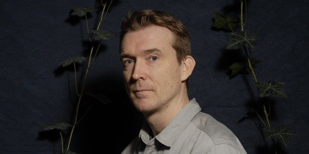 PARIS, FRANCE - DECEMBER 14:  English writer David Mitchell poses during a portrait session held on December 14, 2011 in Pari