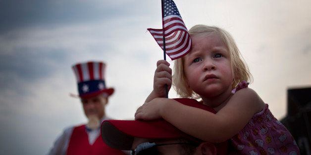 SOUTH RIDING, VA - JULY 3:  With Uncle Sam to her right, Finley Zaiko, 2, watches Republican US Senate candidate and former S