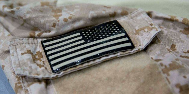 In this Sept. 5, 2014 photo provided by the National September 11 Memorial and Museum, a detail of the fatigue shirt showing
