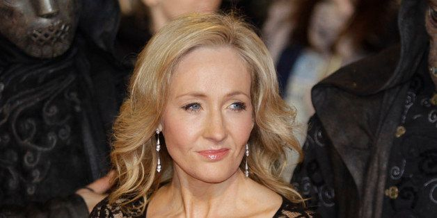 British author JK Rowling poses for the photographers as she attends the world premiere of the latest film' Harry Potter and