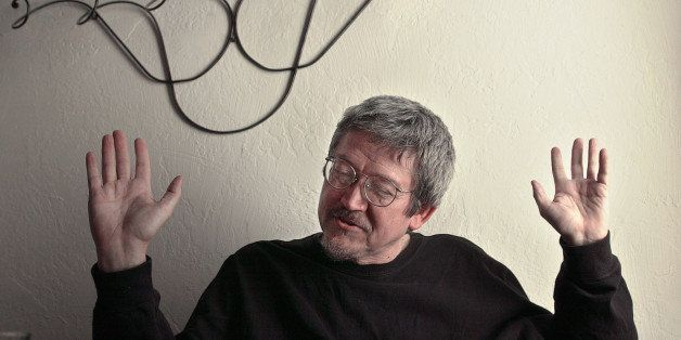 TO GO WITH STORY TITLED AFGHAN AMERICAN WRITER--Afghan-American writer Tamim Ansary gestures during an interview April 15, 20
