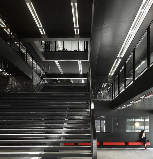 The Utrecht University Library by Wiel Arets is completely black inside, except for the furniture (which is red) and the colo