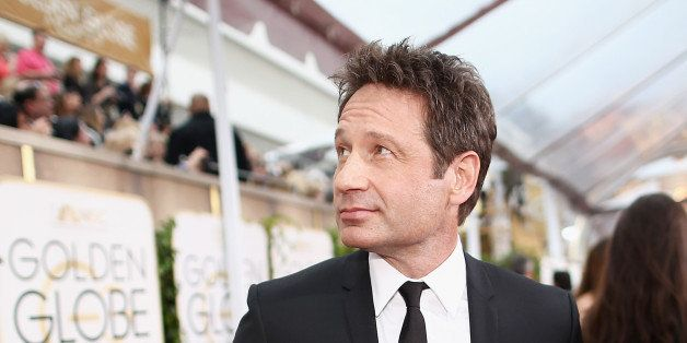 LOS ANGELES, CA - JANUARY 11: 72nd ANNUAL GOLDEN GLOBE AWARDS -- Pictured: Actor David Duchovny arrives to the 72nd Annual Go