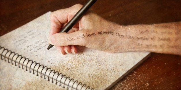 Woman writing poetry in her journal - conceptual image of the creative process