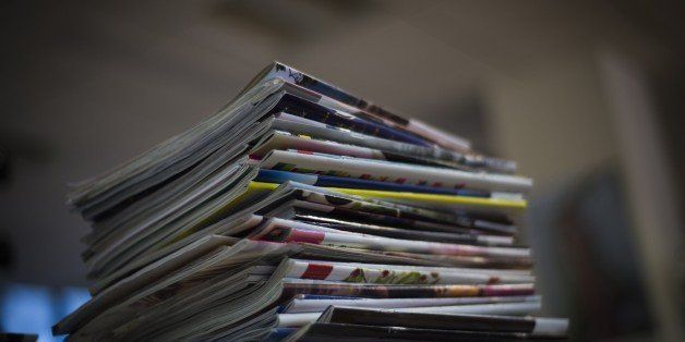 A picture taken on January 14, 2015 in Paris, shows a pile of magazines.  AFP PHOTO / MARTIN BUREAU        (Photo credit shou