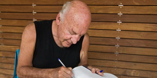 (FILE) Picture taken on April 3, 2009 of Uruguayan writer Eduardo Galeano autographing an edition of 'The Open Veins of Latin