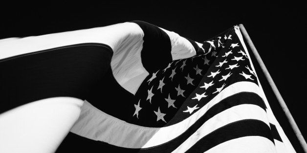 Abstract photograph of an American flag waving in the breeze very closeup. High contrast black and white. Stars and stripes v
