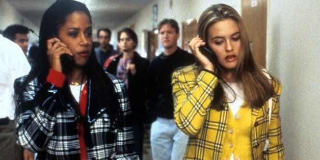 Stacey Dash and Alicia Silverstone walking and talking on their mobile phones in a scene from the film 'Clueless', 1995. (Pho