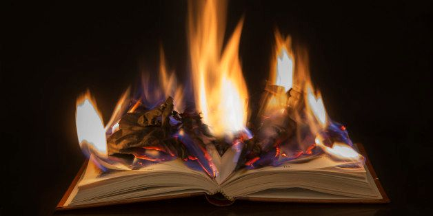 Open book with burning pages