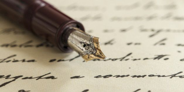 an old fountain pen on a manuscript