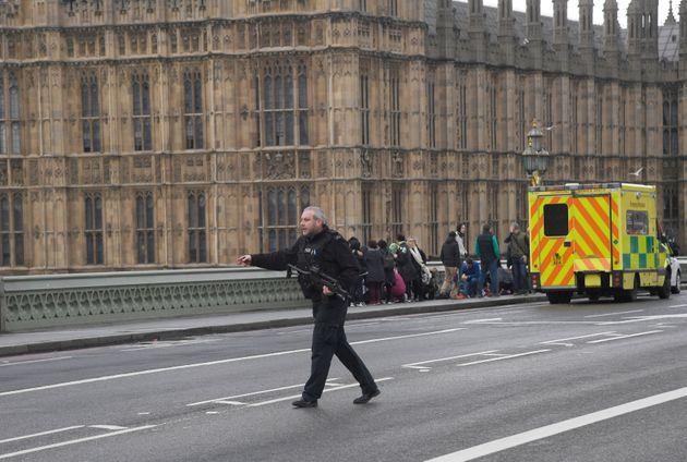 A Reuters news agency photographer captured this photograph of an armed police officer responding during...