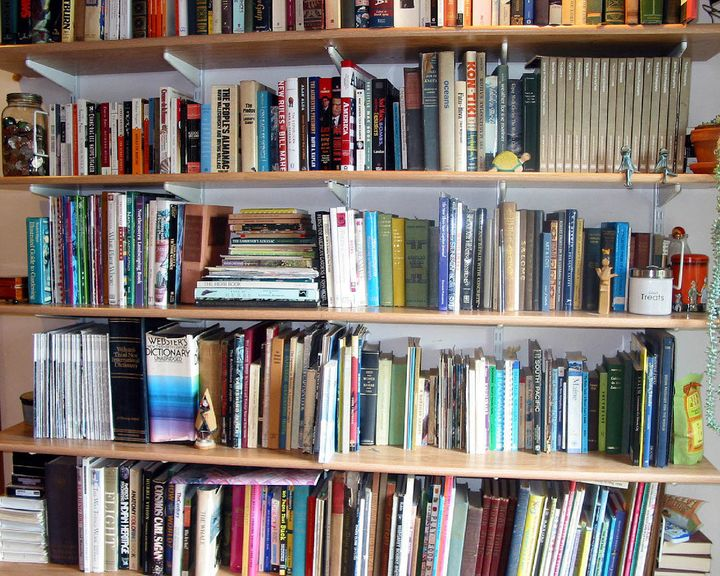 Scroll Bookshelf Holding Books In Place With Tensioned Metal Rolls