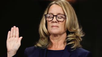 Christine Blasey Ford closes her eyes as she is sworn in before testifying to the Senate Judiciary Committee confirmation hearing for President Donald Trump's Supreme Court nominee Judge Brett Kavanaugh on Capitol Hill in Washington, U.S., September 27, 2018. Picture taken September 27, 2018.  REUTERS/Jim Bourg