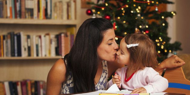 Mother and daughter writing letter to Santa Claus