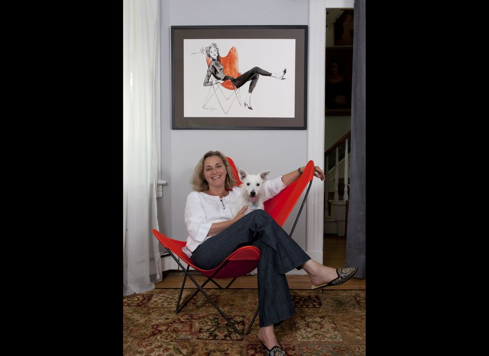 Liz Glasgow sits on the very same butterfly chair in the drawing that hangs behind her, drawn by her mother, famous fashion i