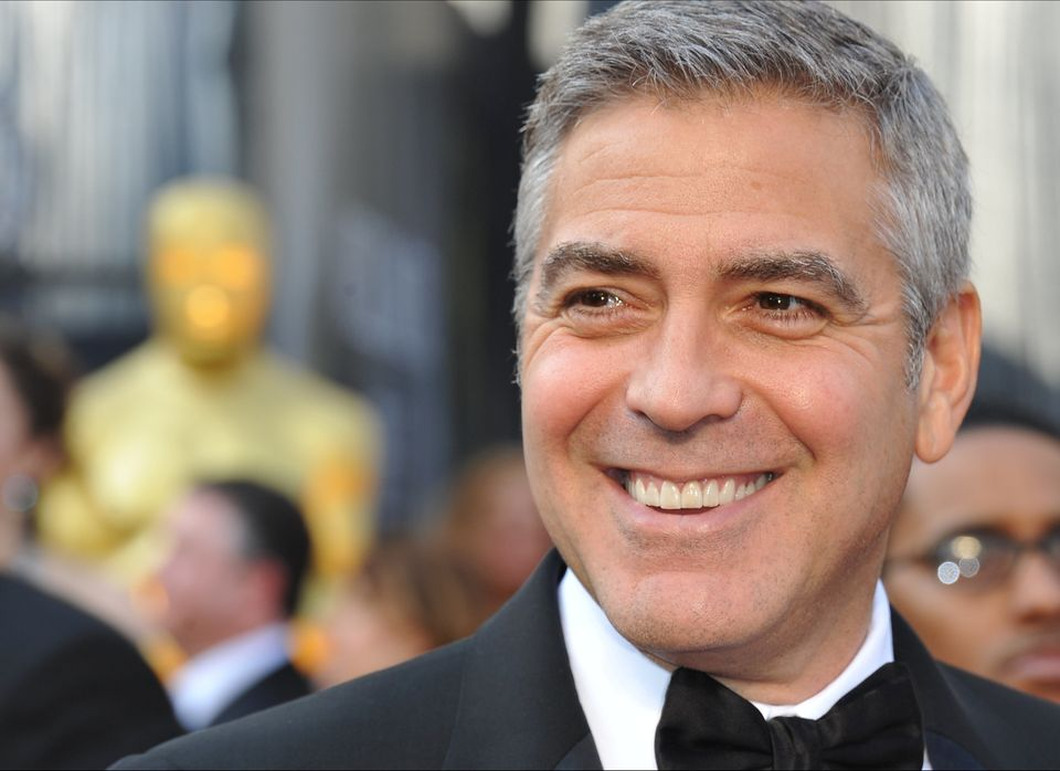 Clooney arrives on the red carpet for the 84th Annual Academy Awards in 2012.