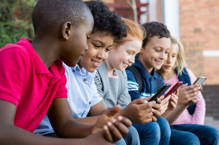 "<p>Cellphones carry certain risks for elementary school students. <a rel=""nofollow"" href=""https://www.shutterstock.com/image-photo/pupils-using-mobile-phone-elementary-school-1088478797?src=vi7mDrXCq1nv_16ZMpqFXg-1-6"" target=""_blank"">Rido&#x2F;www.shutterstock.com</a></p>"