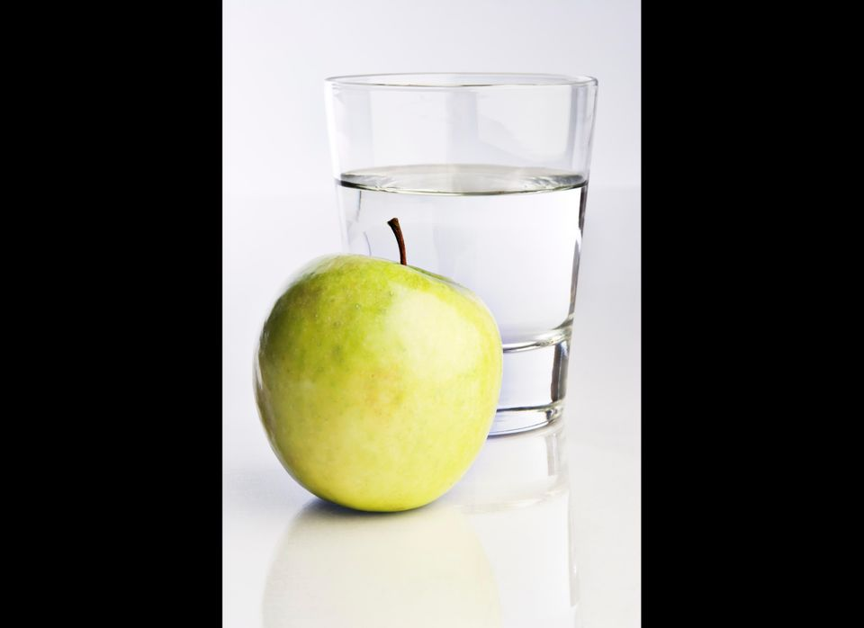Fifteen minutes before your largest meal of the day, eat an apple and drink 12 ounces of water. The average stomach holds app