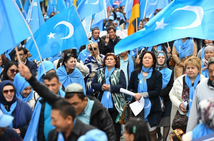 Ethnic Uighurs protesting in Brussels on April 27, 2018, urge the European Union to call upon China to respect human rights i