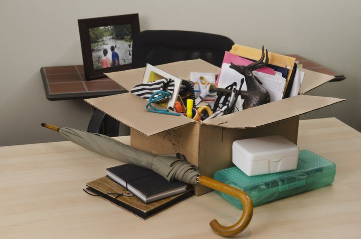 personal property in carton on office desk